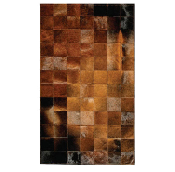 Madre tierra: Patchwork carpet from brown cowhide