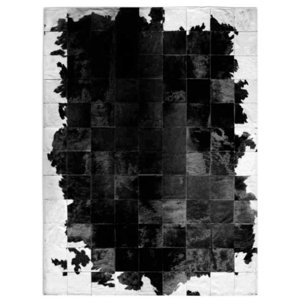 Pasión del tango: Patchwork carpet from black and white cowhide